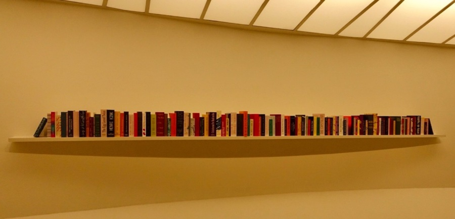 Long bookshelf of books at the Guggenheim Museum, NYC