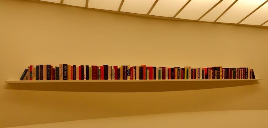 Long bookshelf of books at the Guggenheim Museum, NYC